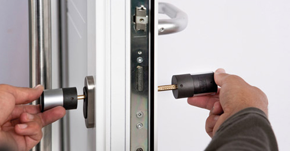 Locksmith installing door lock